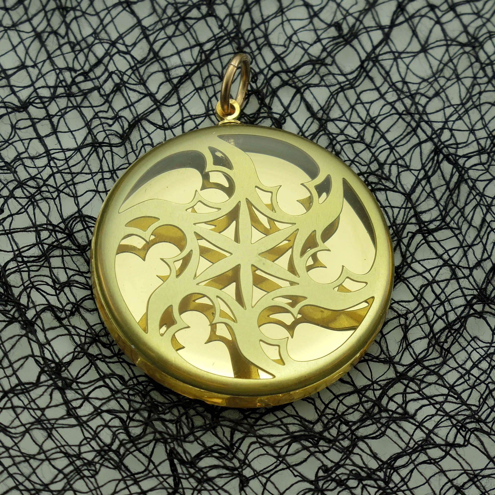 Agressive Spiral Brass and Acrylic Pendant